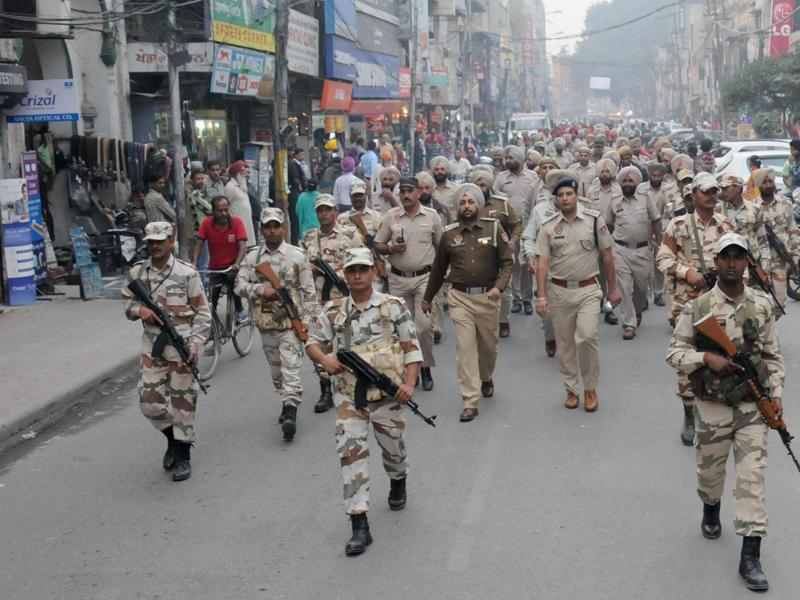 Indian security forces march through the streets of Punjab after Sarbat Khalsa.